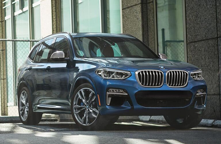Passenger's side front angle view of blue 2019 BMW X3