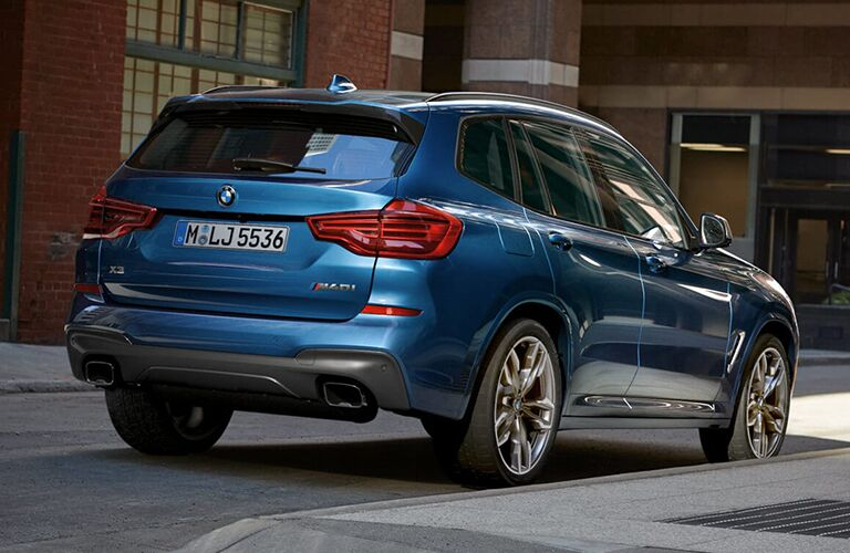 2019 BMW X3 driving downtown