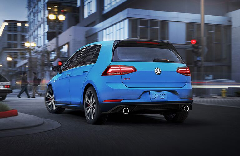 The rear view of a blue 2021 Volkswagen Golf GTI.