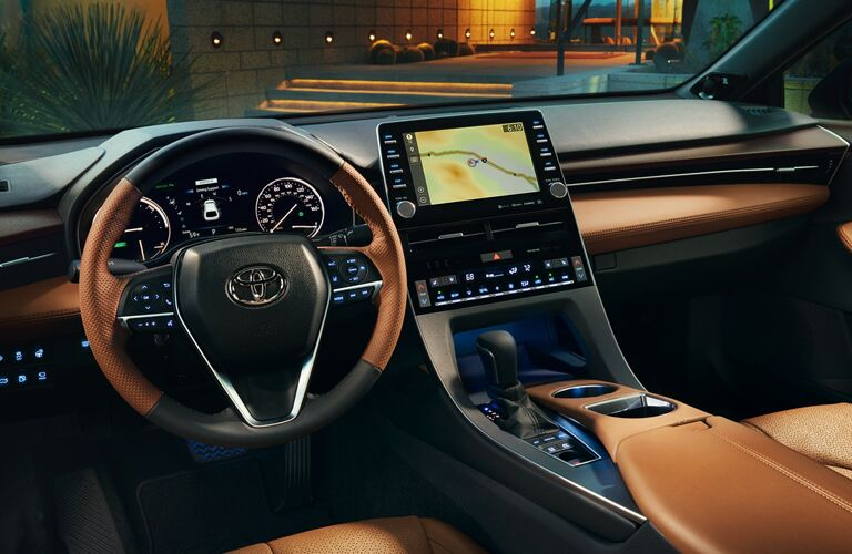 Interior Steering Wheel, Touchscreen, and Dashboard of the 2019 Toyota Avalon Hybrid