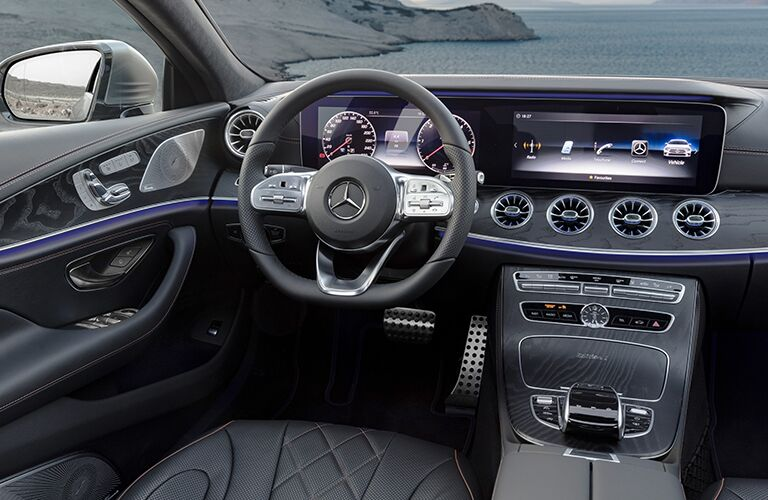 Steering wheel and center touchscreen interfaces inside 2019 Mercedes-Benz CLS
