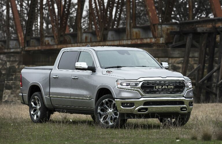 Silver 2020 Ram 1500 parked in front of a railway bridge