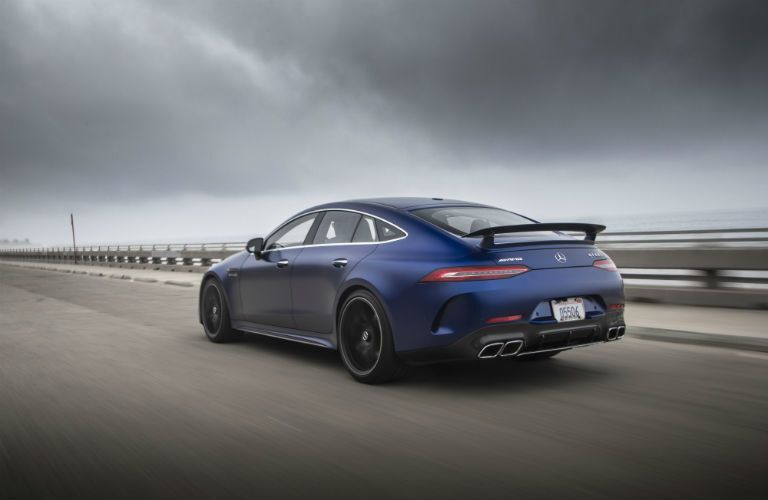 2020 MB GT exterior back fascia driver side on blurred highway with storm clouds overhead
