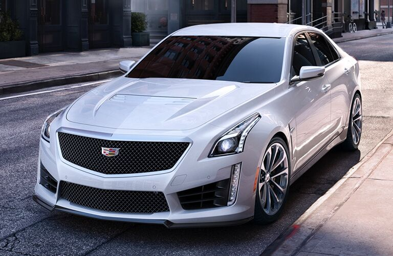 Front driver angle of a white 2019 Cadillac CTS-V parked on the side of a street