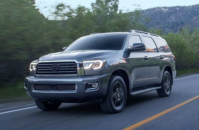 2020 Toyota Sequoia on a wooded road