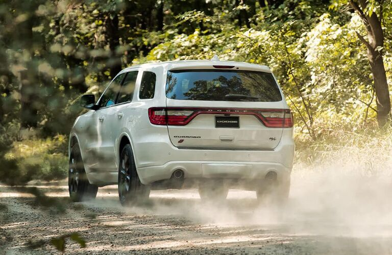 White 2020 Dodge Durango driving through a forest