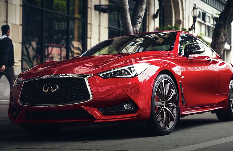 Red 2020 INFINITI Q60 parked on side of road