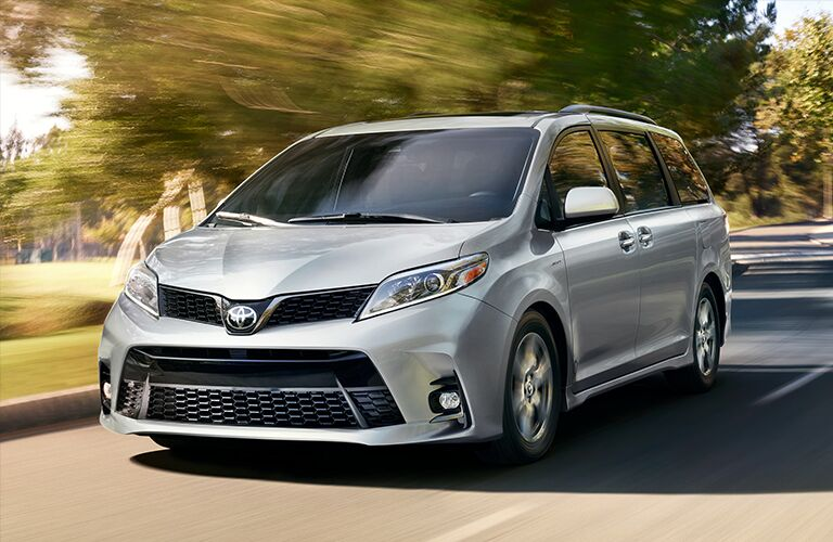 Front Driver Angle of a 2019 Toyota Sienna Driving Down the Road