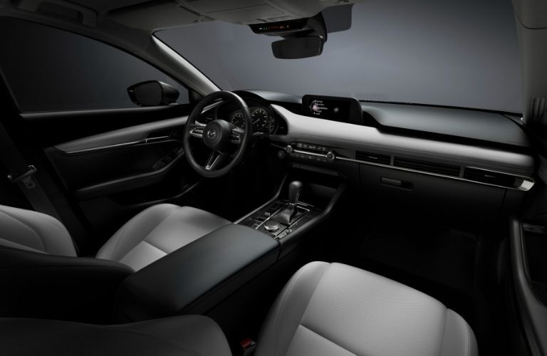 Interior view of the front seating area inside a 2021 Mazda3 Sedan