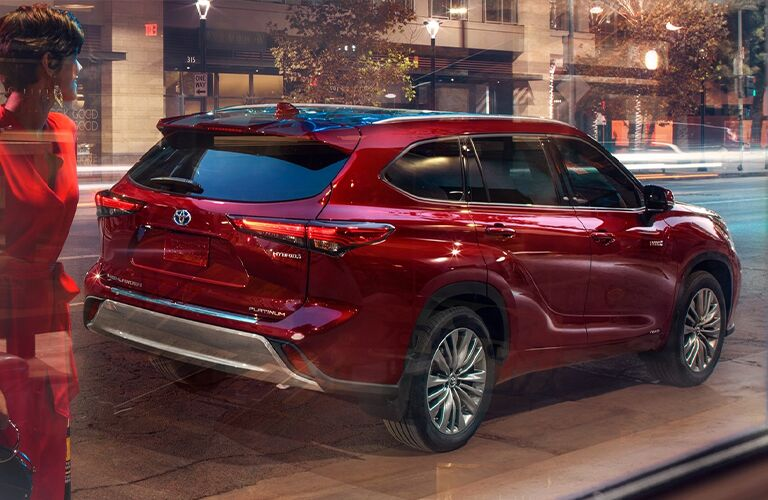 The rear view of a red 2021 Toyota Highlander Hybrid.
