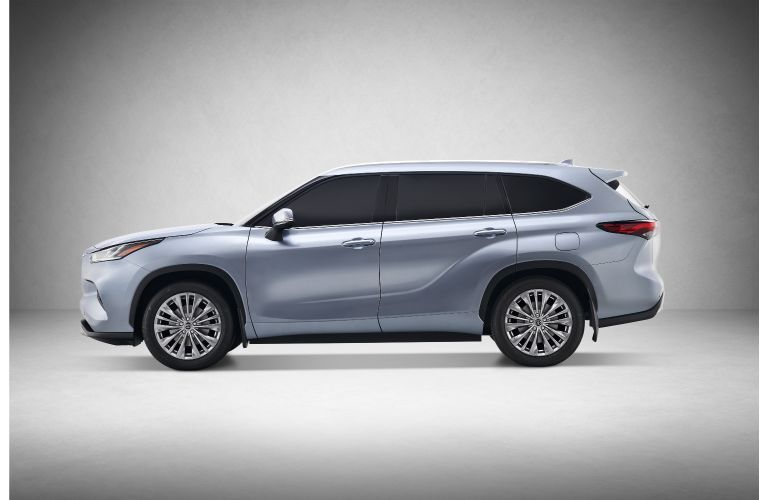 2020 Toyota Highlander redesigned SUV exterior side shot with blue gray silver paint colo