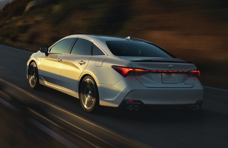 Exterior view of the rear of a silver 2020 Toyota Avalon