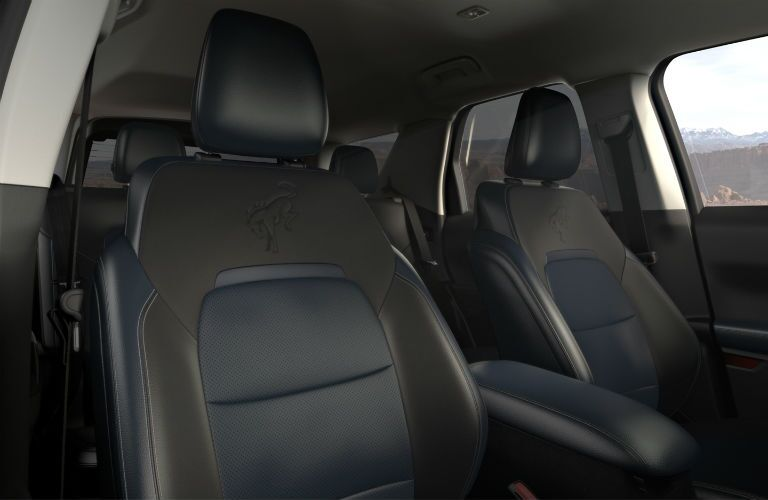The front interior view of the seating inside the 2021 Ford Bronco Sport.