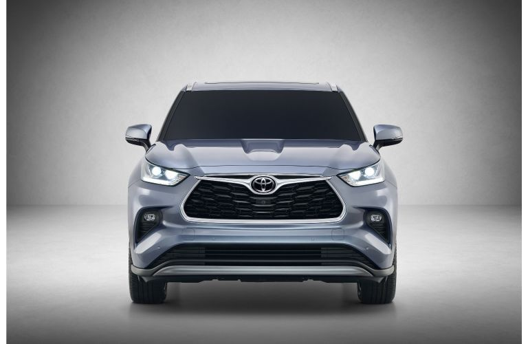 2020 Toyota HIghlander redesigned SUV exterior front shot showing headlight, bumper, and grille design with blue gray silver paint color