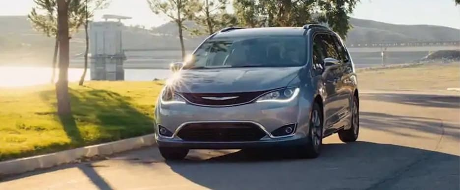 2019 Chrysler Pacifica driving by the water