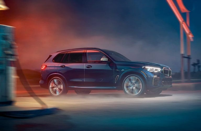 2020 BMW X5 parked outside in d ark