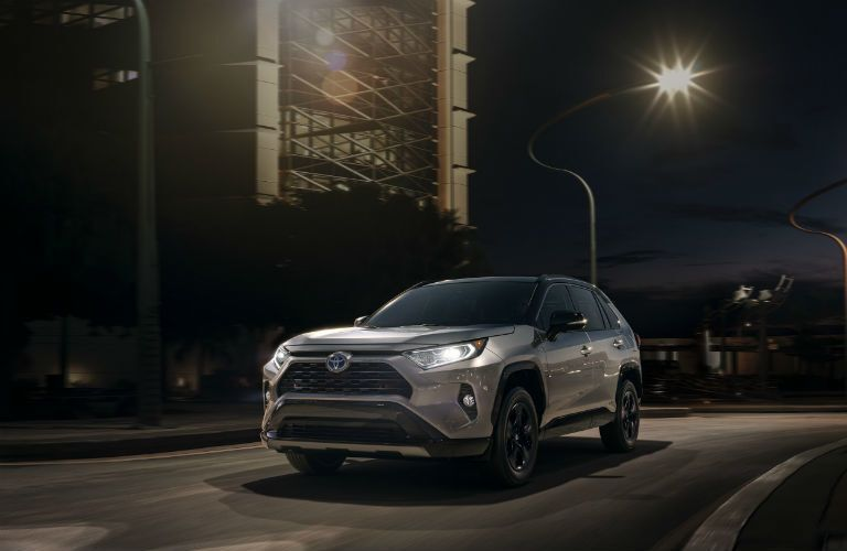 Silver 2020 Toyota RAV4 on City Street at Night