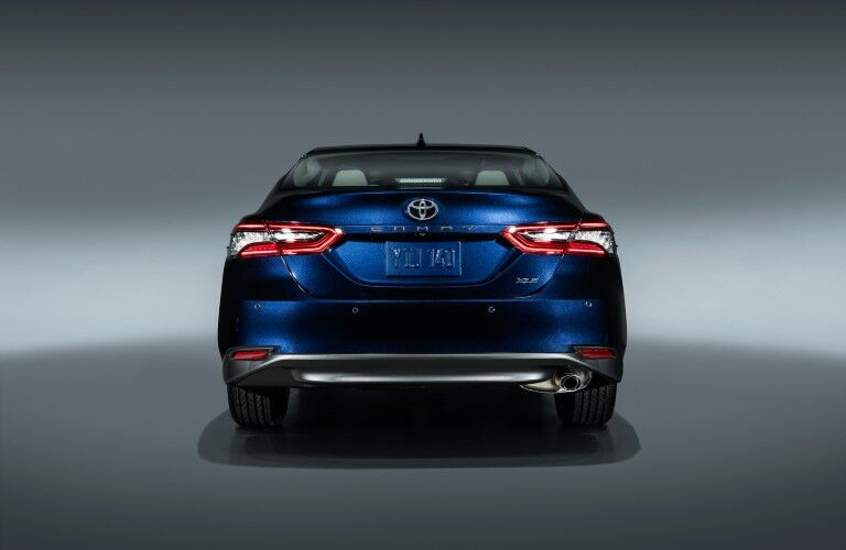 The rear view of a blue 2021 Toyota Camry.