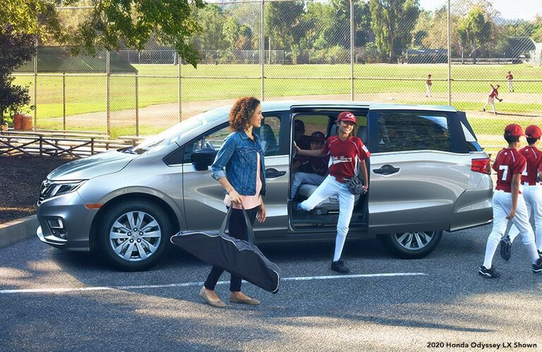 Mother taking her kids to a baseball game with the 2020 Honda Odyssey LX