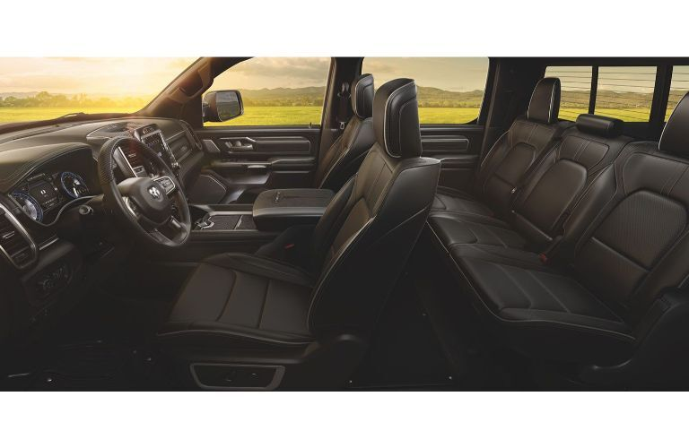 2020 Ram 1500 interior side shot of leather upholstery and ventilated seating along with front steering wheel and dashboard design