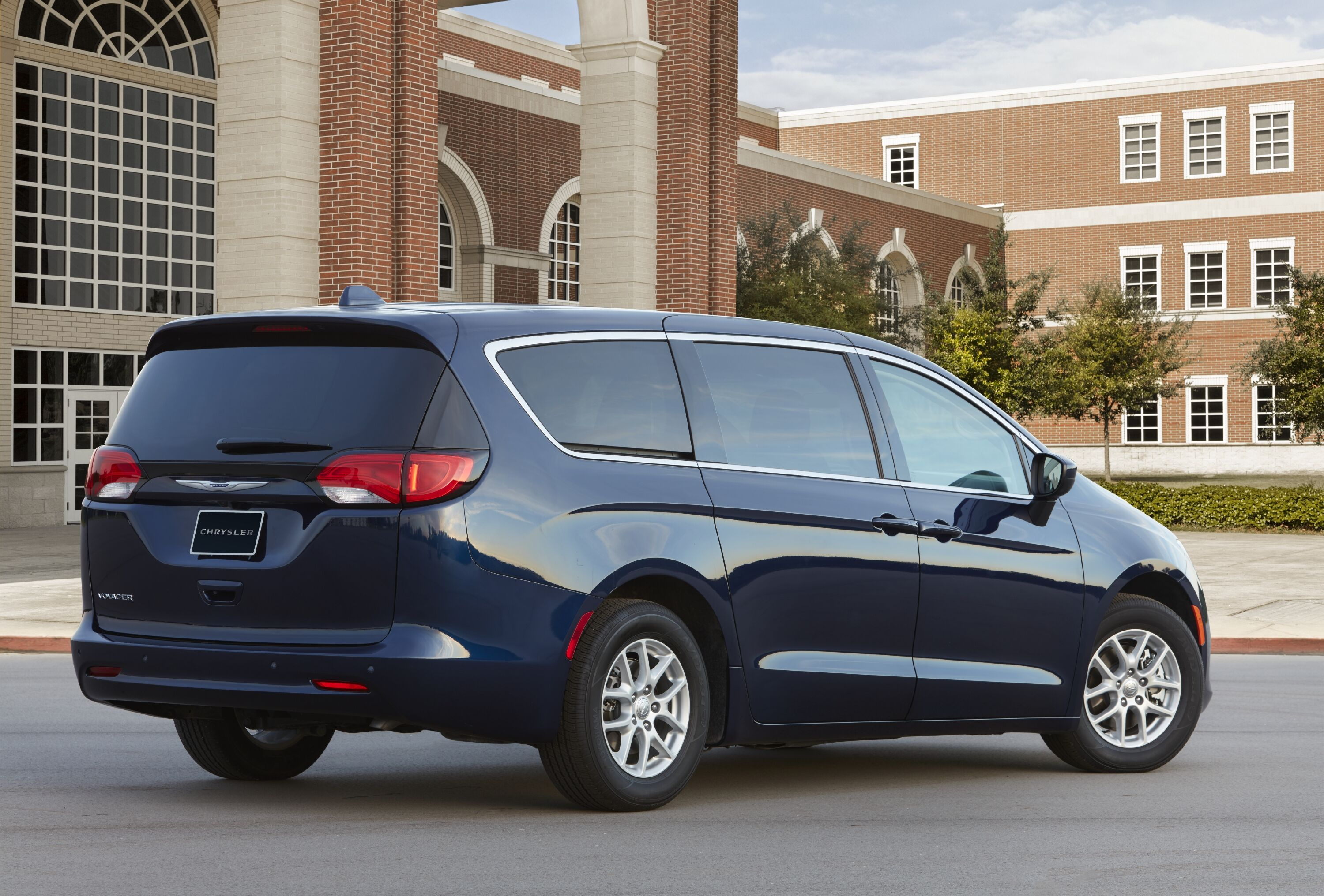 2020 Chrysler Voyager facing old brick buildings