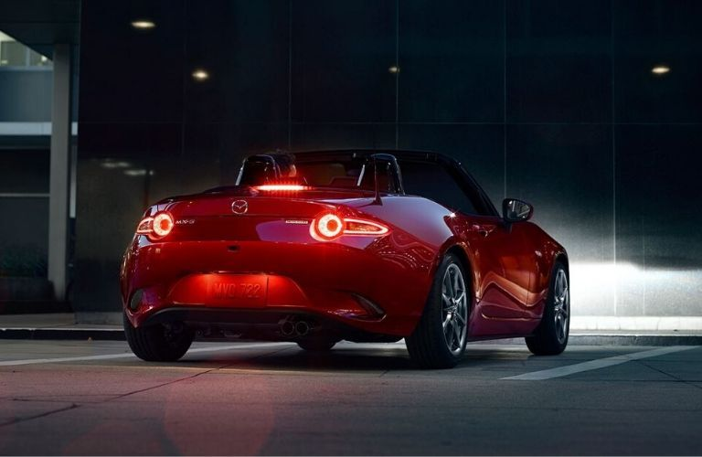 Exterior view of the rear of a red 2020 Mazda MX-5 Miata