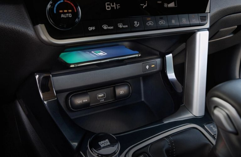 Interior view of the wireless smartphone charging pad available inside a 2021 Kia Seltos