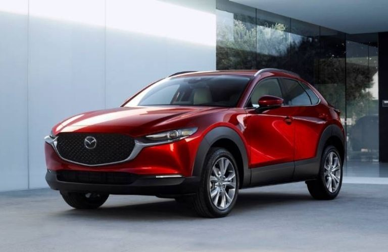 Exterior view of the front of a red 2021 Mazda CX-30