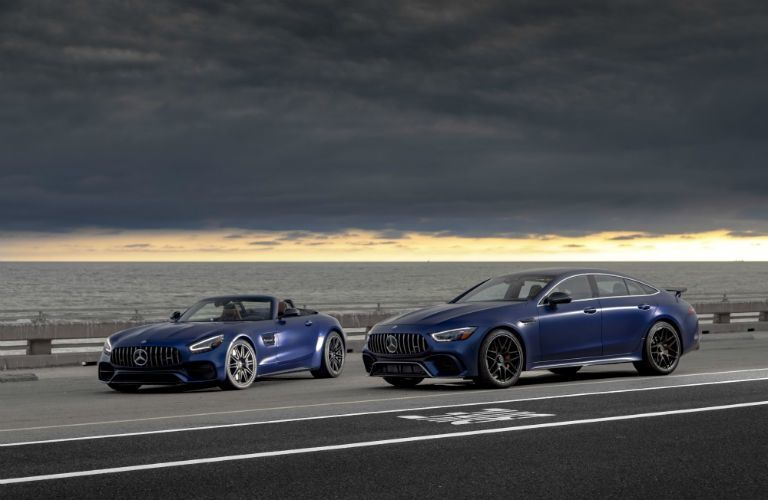 2020 MB GT Coupe exterior front fascia and driver side 2 models one coupe one with top down with storm clouds overhead