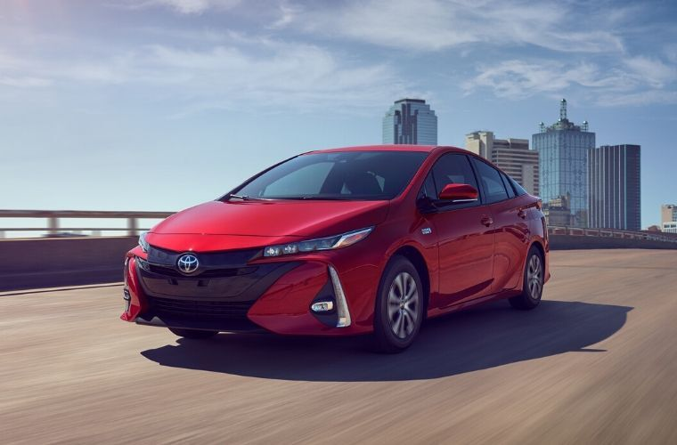 2020 Toyota Prius Prime driving on highway out of the city