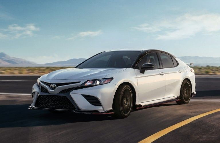 A front left quarter photo of the 2020 Toyota Camry on the road.