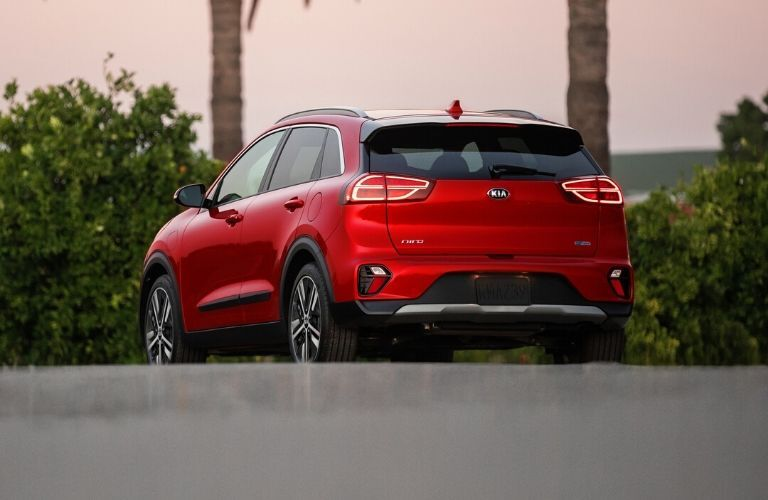 Exterior view of the rear of a red 2020 Kia Niro Plug-In Hybrid