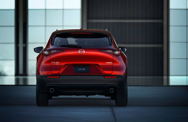 The rear exterior view of a red 2020 Mazda CX-30.
