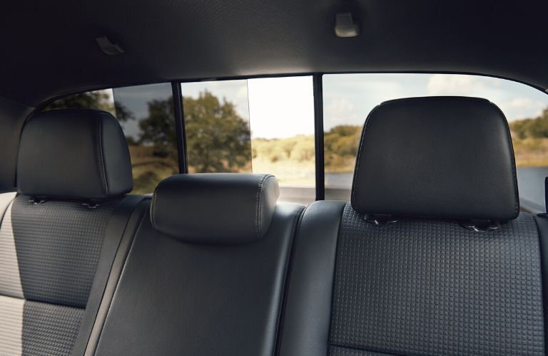 Interior view of the rear seating and power sliding rear window inside the 2020 Toyota Tacoma