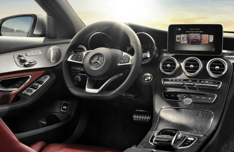 Steering wheel and center console in the 2018 Mercedes-Benz C-Class