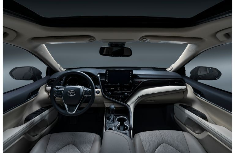 Front interior of the 2021 Toyota Camry as seen from the rear seat