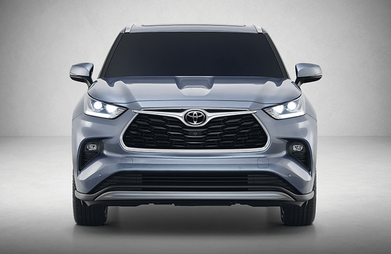 The front side of a light gray 2020 Toyota Highlander.