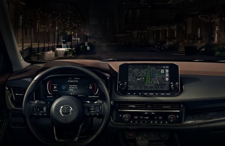 Interior view of the steering wheel and multiple displays inside a 2021 Nissan Rogue