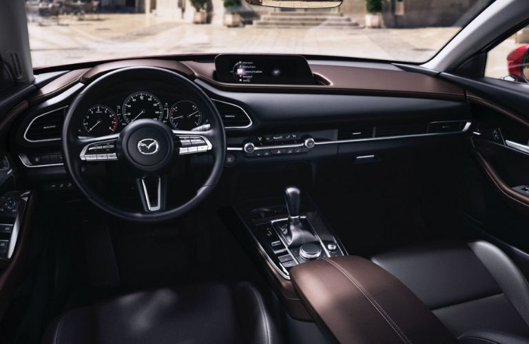 Interior view of the steering wheel and touchscreen display inside a 2021 Mazda CX-30