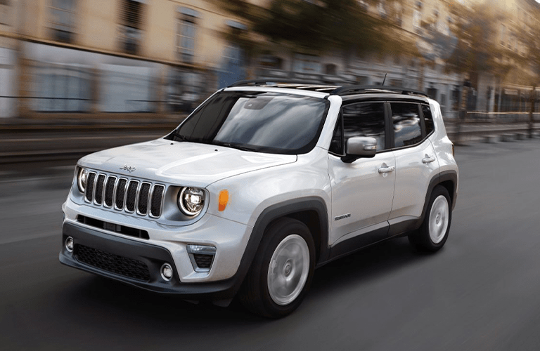 White 2020 Jeep Renegade driving
