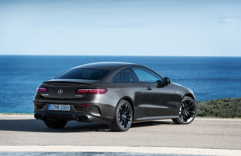 2021 MB E-Class Coupe exterior front fascia passenger side in front of ocean