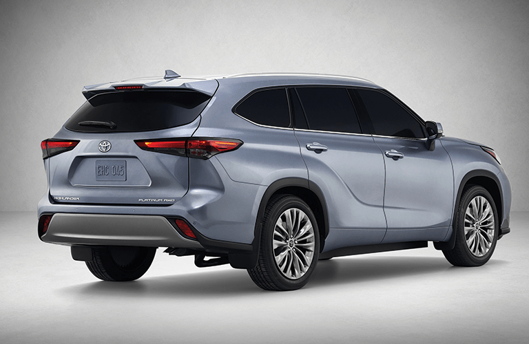 The read and side view of a light gray 2020 Toyota Highlander.