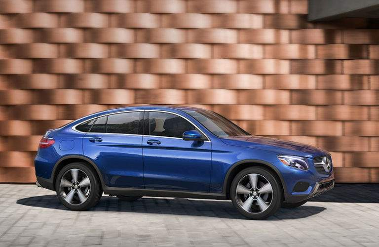 A right profile photo of the 2018 Mercedes-Benz GLC Coupe in blue.