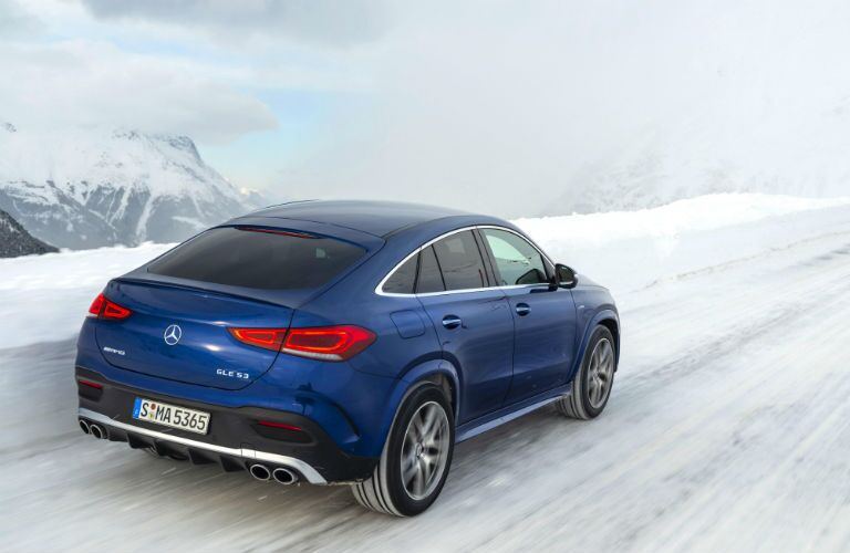2021 MB GLE exterior back fascia passenger side on blurred snowy road