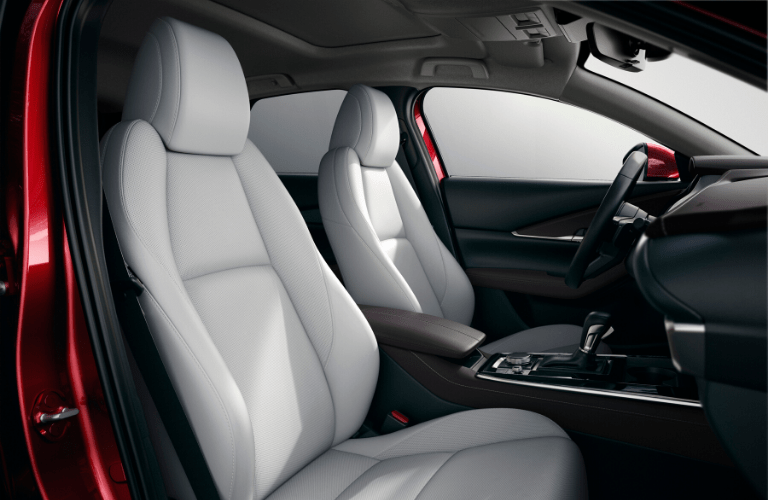 The front interior view of the seats inside a 2020 Mazda CX-30.