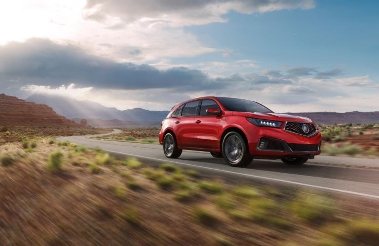 2020 Acura MDX driving on mountain highway