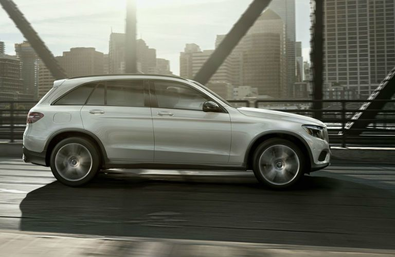 A right profile photo of the 2018 Mercedes-Benz GLC SUV on the road.