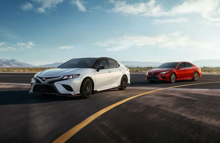 A photo of two 2020 Camry models on a racetrack.