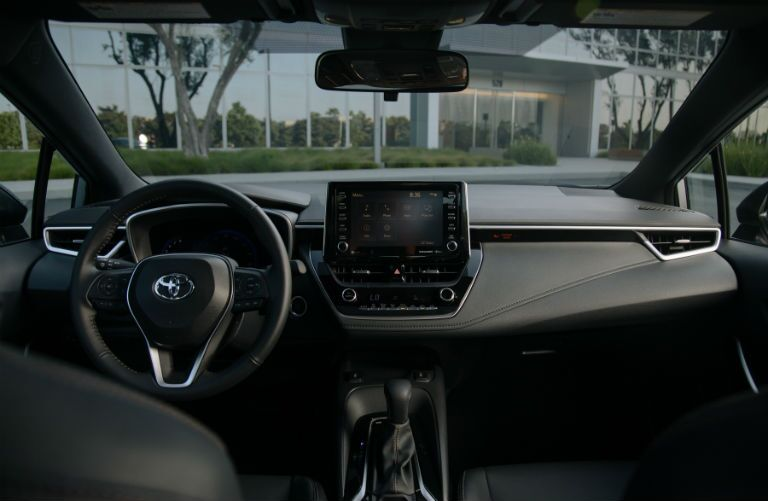 A photo of the driver's cockpit and dashboard in the 2021 Toyota Corolla.