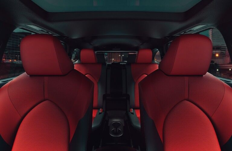The interior view of the red seating inside the 2021 Toyota Highlander.